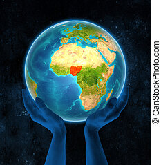 Nigeria on Earth in hands