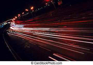 Nigh highway. Cars headlights in motion blur. Long exposure...