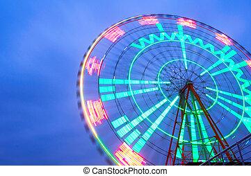 Ferris wheel - Night, a rotating Ferris wheel.