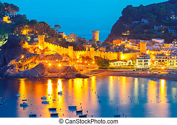 Night aerial view of Tossa de Mar on the Costa Brava, Catalunya, Spain