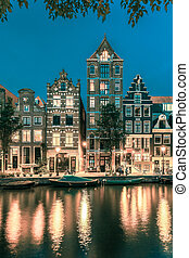Night Amsterdam canal with dutch houses - Night city view of...