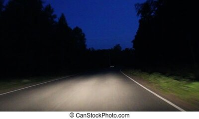 night asphalt road from a moving car