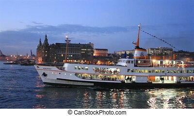 Night at Kadikoy, Istanbul - Beautiful passenger ship sails...