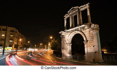 Night Athens. On right we see the Arch of Hadrian that leads...
