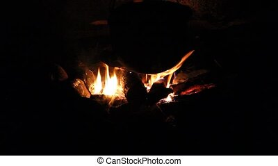 Night. Bonfire. Stir hot coals