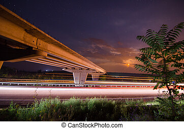 Night bridge to highway
