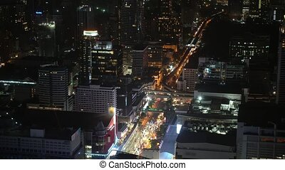 night business district of a metropolis with skyscrapers and financial centers. traffic on a street in a night city