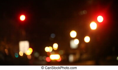 night cab - a cab and pedestrians cross an intersection at...