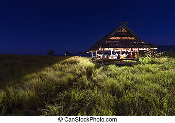 Night camp in kenawa island with small house and beautiful starry sky