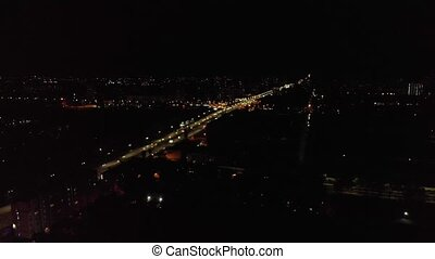 Night car traffic cityscape infrastructure dark aerial drone view