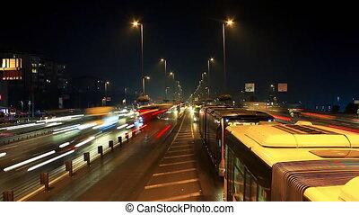 Night car traffic light streaks and street lights on...