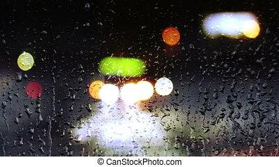 Night cars lights through window