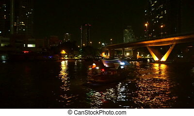 Night Chao Phraya river view in cruise ship at Thailand