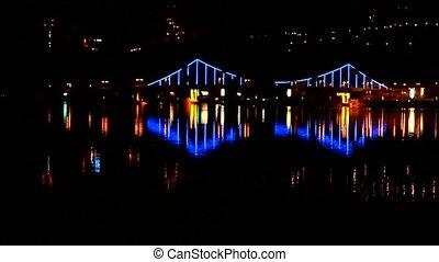 Night city bridge lights over the water