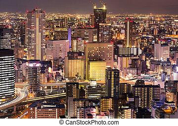 Night city crowded building skyline Osaka Japan