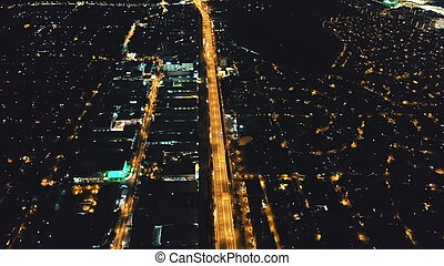 Night city life: illuminated streets, roads aerial. Nightlife of Philippines metropolis town Manila