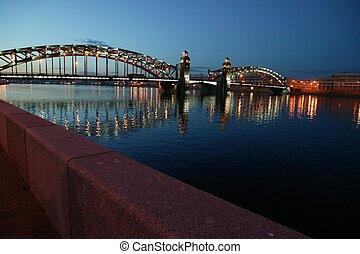 Night city. Lighted bridges and buildings. Bolsheohtinskiy...