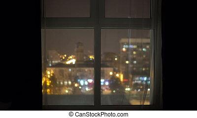 Night city lights high rise apartment window view