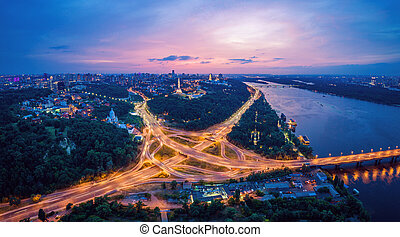 Night city panorama of the Kiev city with the Paton Bridge and the Dnieper River. Ukraine