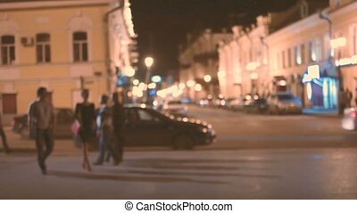 night city scene with pedestrians and cars slow motion toned