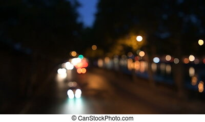 Night city street colorful lights bokeh background.