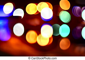 Night city street lights bokeh background, blured coloured light