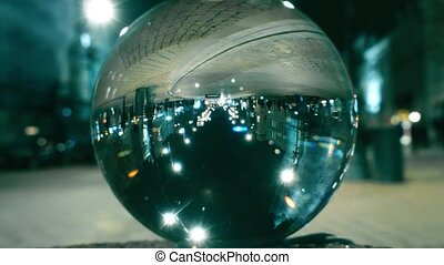Night city street traffic reflecting upside down in the...