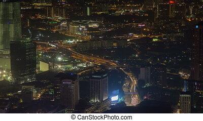 Night city time-lapse sky view with traffic Kuala Lumpur, Malaysia