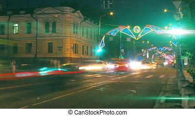 night city traffic on crossroad with festive illumination...
