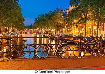 Night city view of Amsterdam canal and bridge - Night city...