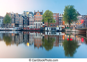 Night city view of Amsterdam canal with dutch houses - ...