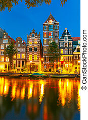 Night city view of Amsterdam canal with dutch houses - Night...