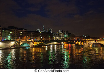 Night city view of the river Seine and bridges in Paris