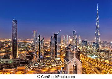 Night cityscape of Dubai with modern futuristic architecture...