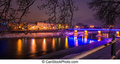 night cityscape panorama of old town in winter