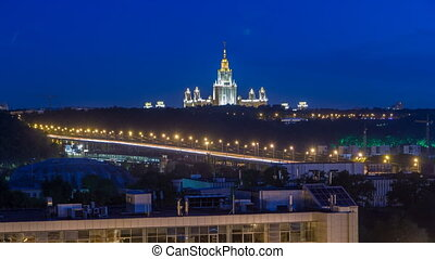 Night cityscape view of Moscow timelapse. View from rooftop to the main building of Moscow State University at night