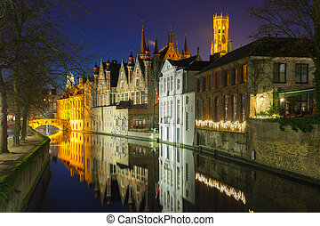 Night cityscape with a tower Belfort and the Green canal in ...