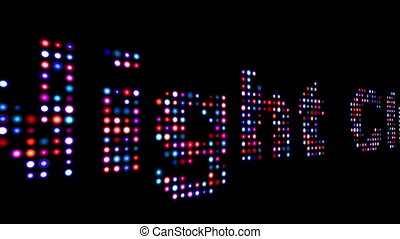 Night club colorful led text over black