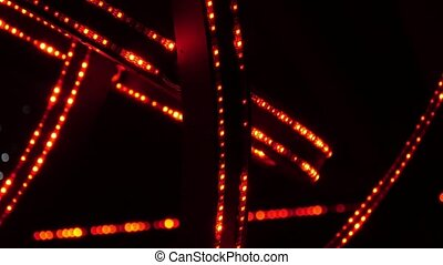 Night club illumination with spotty orange lines in the...