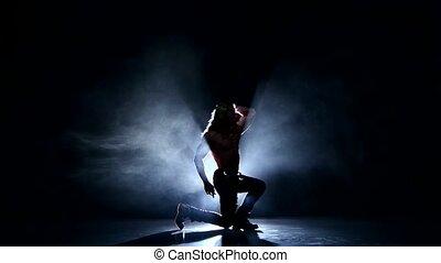 Night club: muscle man model posing in studio