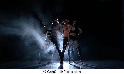 Night club striptease dancer. Strong men and woman. Slow motion, smoke