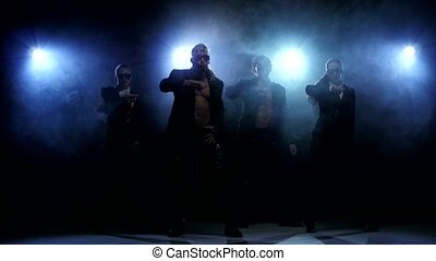 Night club striptease dancers. Strong men and women, smoke