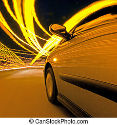 Night Drive - A car, driving through the clutter of lights...