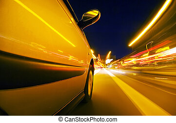Night drive - The exterior of a car driving through an urban...
