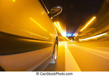 Night drive - The exterior of a car driving through an urban...