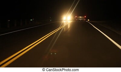 Night drive with approaching car. - Driving at night on a...