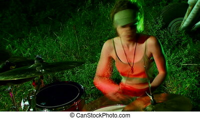 Night drummer - Beautiful girl in a cap sits and plays...