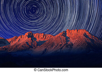 Night Exposure Star Trails of the Sky in Bishop California -...