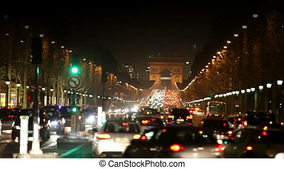 Night fires of cars on the Champs Elysee. Paris. - Night...