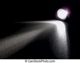 Lighting flashlight at dark night with light like arow